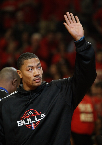 CHICAGO, IL - MAY 01: Derrick Rose #1 of the Chicago Bulls, injured in game one against the Philadelphia 76ers, waves to the crowd before Game Two of the Eastern Conference Quarterfinals during the 2012 NBA Playoffs at the United Center on May 1, 2012 in Chicago, Illinois. NOTE TO USER: User expressly acknowledges and agrees that, by downloading and or using this photograph, User is consenting to the terms and conditions of the Getty Images License Agreement.  (Photo by Jonathan Daniel/Getty Images)