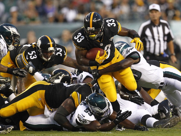PHILADELPHIA - AUGUST 09:   Isaac Redman #33 of the Pittsburgh Steelers tries to break tackle of  Antonio Dixon #90 of the Philadelphia Eagles during a preseason game at Lincoln Financial Field on August 9, 2012 in Philadelphia, Pennsylvania.  (Photo by Jeff Zelevansky/Getty Images)