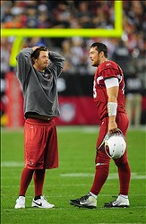 Jan. 1, 2012; Glendale, AZ, USA; Arizona Cardinals injured quarterback Kevin Kolb (left) talks with quarterback John Skelton in the fourth quarter against the Seattle Seahawks at University of Phoenix Stadium. The Cardinals defeated the Seahawks 23-20 in overtime. Mandatory Credit: Mark J. Rebilas-US PRESSWIRE