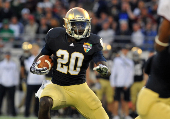 ORLANDO, FL - DECEMBER 29: Running back Cierre Wood #20 of the Notre Dame Fight Irish rushes upfield in the first quarter against the Florida State Seminoles in the Champs Sports Bowl December 29, 2011 at the Florida Citrus Bowl in Orlando, Florida.  (Photo by Al Messerschmidt/Getty Images)
