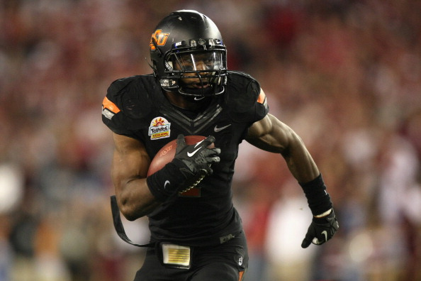 GLENDALE, AZ - JANUARY 02:  Joseph Randle #1 of the Oklahoma State Cowboys scores a 4-yard rushing touchdown in the fourth quarter against the Stanford Cardinal during the Tostitos Fiesta Bowl on January 2, 2012 at University of Phoenix Stadium in Glendale, Arizona.  (Photo by Donald Miralle/Getty Images)