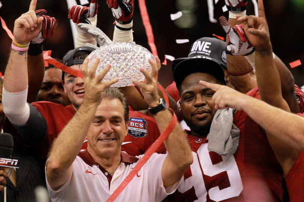 NEW ORLEANS, LA - JANUARY 09:  Head coach Nick Saban of the Alabama Crimson Tide celebrates with the trophy after defeating Louisiana State University Tigers in the 2012 Allstate BCS National Championship Game at Mercedes-Benz Superdome on January 9, 2012 in New Orleans, Louisiana.  (Photo by Ronald Martinez/Getty Images)