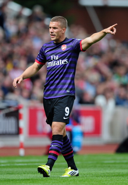 STOKE ON TRENT, ENGLAND - AUGUST 26: Lukas Podolski of Arsenal in action during the Barclays Premier League match between Stoke City and Arsenal at The Britannia Stadium on August 26, 2012 in Stoke on Trent, England.  (Photo by Laurence Griffiths/Getty Images)