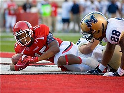 Sep 1, 2011; Salt Lake City, UT, USA; Utah Utes running back John White IV (15) scores a touchdown past Montana State Bobcats defensive back Steven Bethley (28) during the first half at Rice Eccles Stadium.  Mandatory Credit: Russ Isabella-US PRESSWIRE