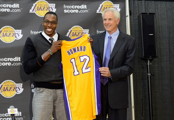EL SEGUNDO, CA - AUGUST 10:  Dwight Howard (L) is introduced to the media as the newest member of the Los Angeles Lakers by General Manager Mitch Kupchak during a news conference at the Toyota Sports Center on August 10, 2012 in El Segundo, California. The Lakers aquired Howard from Orlando Magic in a four-team trade. In addition, Lakers wil receive Chris Duhon and Earl Clark from the Magic.  (Photo by Kevork Djansezian/Getty Images)