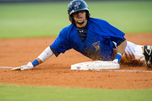 PENSACOLA, FL - AUGUST 21:  Billy Hamilton #4 of the Pensacola Blue Wahoos slides safely into third base against the Montgomery Biscuits at Community Maritime Park Stadium on August 21, 2012 in Pensacola,  Florida. Billy Hamilton broke the minor league record with 146 stolen bases.  (Photo by Michael Chang/Getty Images)