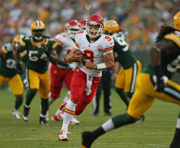 GREEN BAY, WI - AUGUST 30:  Brady Quinn #9 of the Kansas City Chiefs runs for a first down against the Green Bay Packers during a preseason game at Lambeau Field on August 30, 2012 in Green Bay, Wisconsin.  (Photo by Jonathan Daniel/Getty Images)