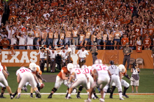 AUSTIN, TX - SEPTEMBER 9:  Fans have painted 'Texas Fight' on their midsections in support of the University of Texas at Austin Longhorns during the game against the Ohio State University Buckeyes on September 9, 2006 at Texas Memorial Stadium in Austin, Texas. Ohio State won 24-7. (Photo by Ronald Martinez/Getty Images)