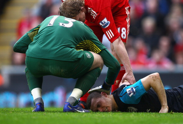 LIVERPOOL, ENGLAND - MARCH 03:  Thomas Vermaelen of Arsenal lies injured on the pitch during the Barclays Premier League match between Liverpool and Arsenal at Anfield on March 3, 2012 in Liverpool, England.  (Photo by Clive Mason/Getty Images)