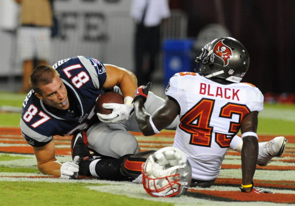 TAMPA, FL - AUGUST 24:  Tight end Rob Gronkowski #87 of the New England Patriots loses his helmet after a touchdown catch against the Tampa Bay Buccaneers at Raymond James Stadium in a pre-season game August 24, 2012  in Tampa, Florida.  The Bucs won 30 - 28. (Photo by Al Messerschmidt/Getty Images)
