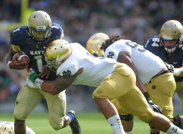 DUBLIN, IRELAND - SEPTEMBER 01:  Navy's Trey Miller being tackled by Notre Dame's Everett Golson during the Notre Dame vs Navy game at Aviva Stadium on September 1, 2012 in Dublin, Ireland.(Photo by Barry Cronin/Getty Images)