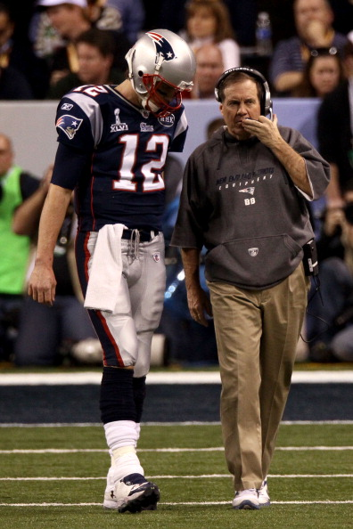 INDIANAPOLIS, IN - FEBRUARY 05:  Tom Brady #12 of the New England Patriots talks with head coach Bill Belichick against the New York Giants during Super Bowl XLVI at Lucas Oil Stadium on February 5, 2012 in Indianapolis, Indiana.  (Photo by Win McNamee/Getty Images)