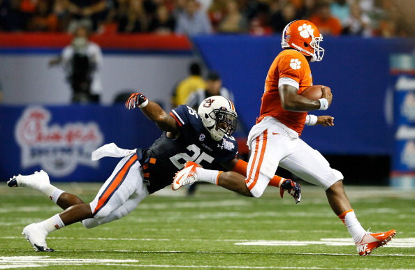 ATLANTA, GA - SEPTEMBER 01:  Tajh Boyd #10 of the Clemson Tigers rushes away from Daren Bates #25 of the Auburn Tigers at Georgia Dome on September 1, 2012 in Atlanta, Georgia.  (Photo by Kevin C. Cox/Getty Images)