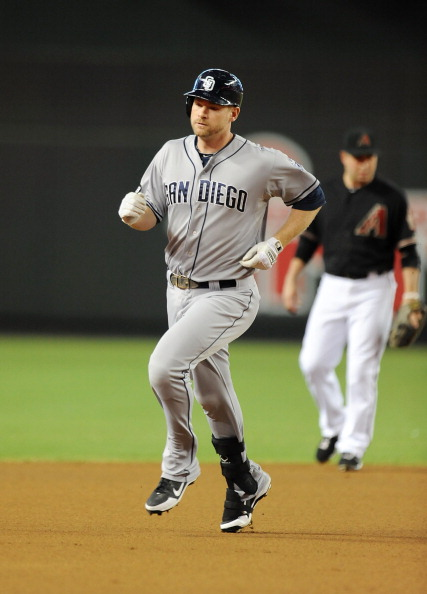 PHOENIX, AZ - AUGUST 25: Chase Headley #7 of the San Diego Padres rounds the bases after hitting a home run against the Arizona Diamondbacks at Chase Field on August 25, 2012 in Phoenix, Arizona. (Photo by Norm Hall/Getty Images)