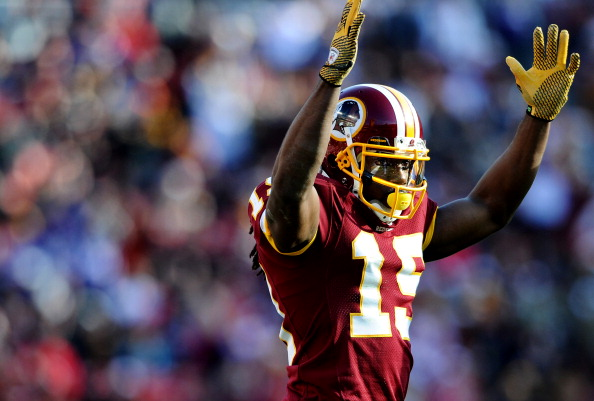 LANDOVER, MD - DECEMBER 24: Wide receiver Jabar Gaffney #10 of the Washington Redskins celebrates his touchdown score against the Minnesota Vikings in the second quarter at FedEx Field on December 24, 2011 in Landover, Maryland. (Photo by Patrick Smith/Getty Images)
