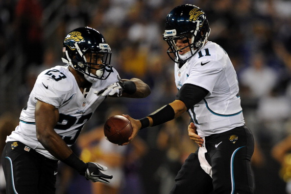 BALTIMORE, MD - AUGUST 23: Running back Rashad Jennings #23 of the Jacksonville Jaguars gets a handoff from quarterback Blaine Gabbert #11 of the Jacksonville Jaguars against the Baltimore Ravens during the preseason game at M&T Bank Stadium on August 23, 2012 in Baltimore, Maryland. The Baltimore Ravens won 48-17. (Photo by Patrick Smith/Getty Images)