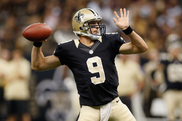 NEW ORLEANS, LA - AUGUST 25:   Drew Brees #9 of the New Orleans Saints throws a pass against the Houston Texans at the Mercedes-Benz Superdome on August 25, 2012 in New Orleans, Louisiana.  (Photo by Chris Graythen/Getty Images)