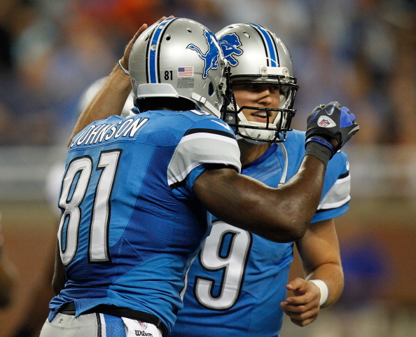 DETROIT, MI - AUGUST 30:  Calvin Johnson #81 of the Detroit Lions celebrates a first quarter touchdown with   Matthew Stafford #9 while playing the Buffalo Bills during a pre season game at Ford Field on August 30, 2012 in Detroit, Michigan. (Photo by Gregory Shamus/Getty Images)