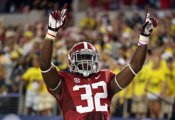 ARLINGTON, TX - SEPTEMBER 01:  C.J. Mosley #32 of the Alabama Crimson Tide celebrates a touchdown interception against the Michigan Wolverines at Cowboys Stadium on September 1, 2012 in Arlington, Texas.  (Photo by Ronald Martinez/Getty Images)