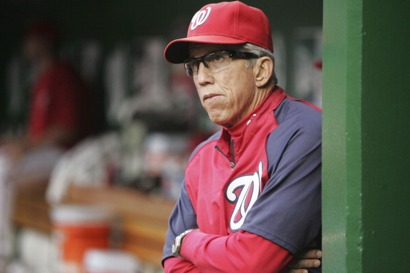 WASHINGTON, DC - AUGUST 19:  Manager Davey Johnson of the Washington Nationals stands in the dugout before his team's game against the New York Mets at Nationals Park on August 19, 2012 in Washington, DC.  (Photo by Jonathan Ernst/Getty Images)