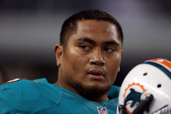 ARLINGTON, TX - AUGUST 29:  Isaako Aaitui #95 of the Miami Dolphins at Cowboys Stadium on August 29, 2012 in Arlington, Texas.  (Photo by Ronald Martinez/Getty Images)