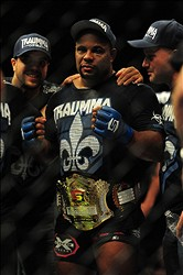May 19, 2012; San Jose, CA, USA; Daniel Cormier celebrates with the championship belt after defeating Josh Barnett (not pictured) during the heavyweight tournament final bout of the Strikeforce World Grand Prix at HP Pavilion.  Mandatory Credit: Kyle Terada-US PRESSWIRE