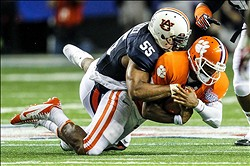 September 1, 2012; Atlanta, GA, USA; Clemson Tigers quarterback Tajh Boyd (10) is sacked by Auburn Tigers defensive end Corey Lemonier (55) in the first half at the Georgia Dome. Mandatory Credit: Daniel Shirey-US PRESSWIRE