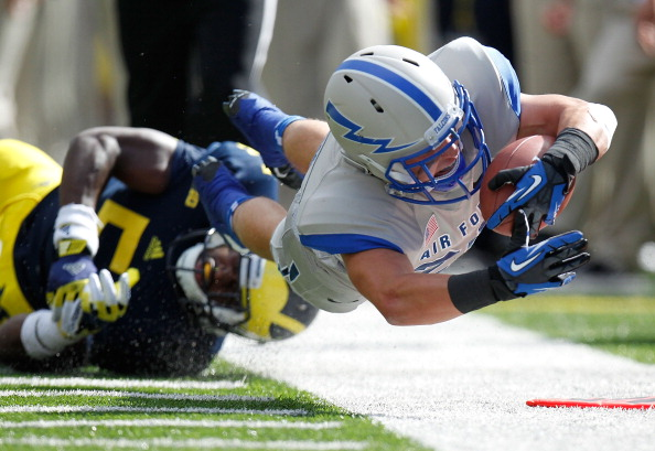 ANN ARBOR, MI - SEPTEMBER 08:  Cody Getz #28 of the Air Force Falcons dives for a first down in front of Courtney Avery #5 of the Michigan Wolverines during a first quarter run at Michigan Stadium on September 8, 2012 in Ann Arbor, Michigan. (Photo by Gregory Shamus/Getty Images)
