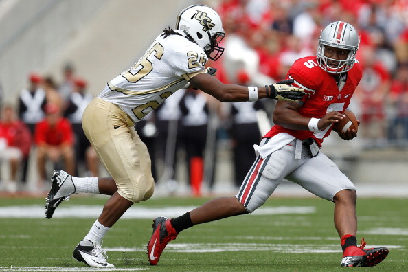 COLUMBUS, OH - SEPTEMBER 8:  Clayton Geathers #26 of the Central Florida Knights chases after Braxton Miller #5 of the Ohio State Buckeyes during the third quarter on September 8, 2012 at Ohio Stadium in Columbus, Ohio. Ohio defeated Central Florida 31-16. (Photo by Kirk Irwin/Getty Images)