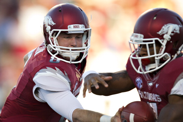 LITTLE ROCK, AR - SEPTEMBER 8:   Tyler Wilson #8 hands off the ball to Knile Davis #7 of the Arkansas Razorbacks during a game against the Louisiana-Monroe Warhawks at War Memorial Stadium on September 8, 2012 in Little Rock, Arkansas.  The Warhawks defeated the Razorbacks 34-31.  (Photo by Wesley Hitt/Getty Images)