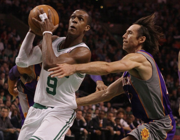 BOSTON, MA - MARCH 02:  Rajon Rondo #9 of the Boston Celtics heads for the net as Steve Nash #13 of the Phoenix Suns defends on March 2, 2011 at the TD Garden in Boston, Massachusetts.  NOTE TO USER: User expressly acknowledges and agrees that, by downloading and/or using this Photograph, User is consenting to the terms and conditions of the Getty Images License Agreement.  (Photo by Elsa/Getty Images)