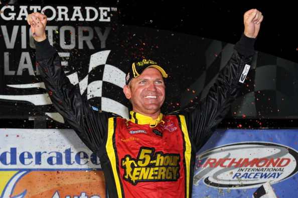 RICHMOND, VA - SEPTEMBER 08:  Clint Bowyer, driver of the #15 5-hour Energy Toyota, celebrates in victory lane after winning the NASCAR Sprint Cup Series Federated Auto Parts 400 at Richmond International Raceway on September 8, 2012 in Richmond, Virginia.  (Photo by Patrick Smith/Getty Images for NASCAR)