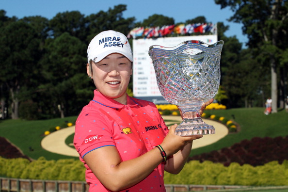 WILLIAMSBURG, VA - SEPTEMBER 10: Jiyai Shin of South Korea holds the championship trophy after winning the Kingsmill Championship at Kingsmill Resort on September 10, 2012 in Williamsburg, Virginia. (Photo by Hunter Martin/Getty Images)