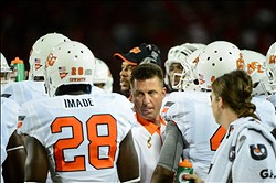Sept. 8, 2012; Tucson, AZ, USA; Oklahoma State Cowboys head coach Mike Gundy talks with players during the first half against the Arizona Wildcats at Arizona Stadium. Mandatory Credit: Matt Kartozian-US PRESSWIRE