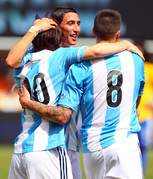 EAST RUTHERFORD, NJ - JUNE 9: Lionel Messi #10 of Argentina celebrates with teammates Jose Sosa #8 and Angel di Mar'a #7 after scoring his second of three goals in an international friendly soccer match on June 9, 2012 at MetLife Stadium in East Rutherford, New Jersey. (Photo by Rich Schultz/Getty Images)