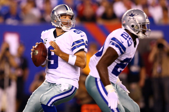 EAST RUTHERFORD, NJ - SEPTEMBER 05:  quarterback Tony Romo #9 of the Dallas Cowboys drops back to pass as running back DeMarco Murray #29 blocks against the New York Giants during the 2012 NFL season opener at MetLife Stadium on September 5, 2012 in East Rutherford, New Jersey.  (Photo by Al Bello/Getty Images)
