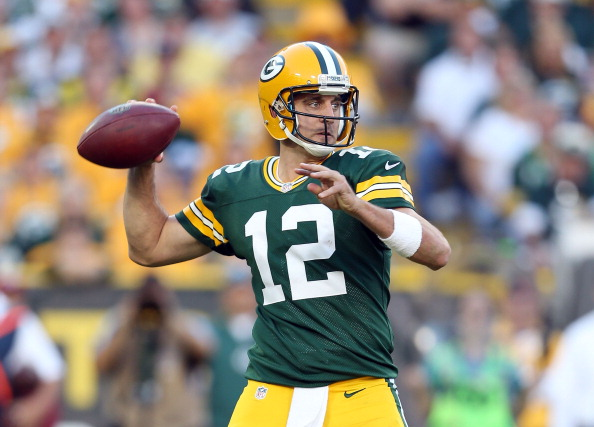 GREEN BAY, WI - SEPTEMBER 09:  Aaron Rodgers #12 of the Green Bay Packers throws a pass during the NFL season opener against the San Francisco 49ers at Lambeau Field on September 9, 2012 in Green Bay, Wisconsin.  (Photo by Andy Lyons/Getty Images)