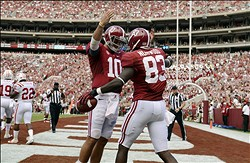 September 8, 2012; Tuscaloosa, AL, USA;  Alabama Crimson Tide wide receiver Christion Jones (22) celebrates his touchdown pass against the Western Kentucky Hilltoppers with teammate quarterback A.J. McCarron (10)during the second half at Bryant Denny Stadium. The Alabama Crimson Tide defeated the Western Kentucky Hilltoppers 35-0.  Mandatory Credit: John David Mercer-US PRESSWIRE