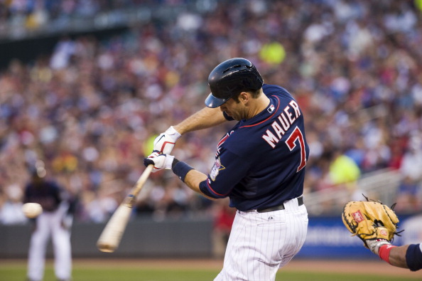 MINNEAPOLIS, MN - SEPTEMBER 8:  Joe Mauer #7 of the Minnesota Twins flies out in the first inning against the Cleveland Indians at Target Field on September 8, 2012 in Minneapolis, Minnesota.  (Photo by Marilyn Indahl/Getty Images)