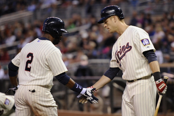 MINNEAPOLIS, MN - SEPTEMBER 12: Justin Morneau #33 of the Minnesota Twins congratulates Denard Span #2 on scoring against the Kansas City Royals during the first inning on September 12, 2012 at Target Field in Minneapolis, Minnesota. (Photo by Hannah Foslien/Getty Images)