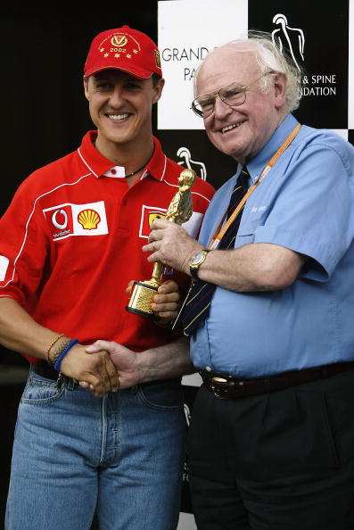 INDIANAPOLIS - SEPTEMBER 28:  Ferrari driver Michael Schumacher of Germany and Formula One Doctor Sid Watkins with the Bernie Award during the second practice for the US Formula One Grand Prix held on September 28, 2002 at the Indianapolis Motorspeedway, in Indianapolis, USA. (Photo by Getty Images)
