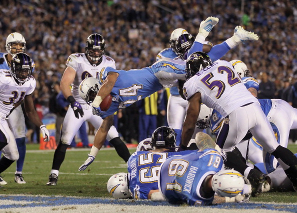 SAN DIEGO, CA - DECEMBER 18:  Running back Ryan Mathews #24 of the San Diego Chargers dives over the pile for a touchdown in the third quarter against the Baltimore Ravens at Qualcomm Stadium on December 18, 2011 in San Diego, California.  (Photo by Jeff Gross/Getty Images)