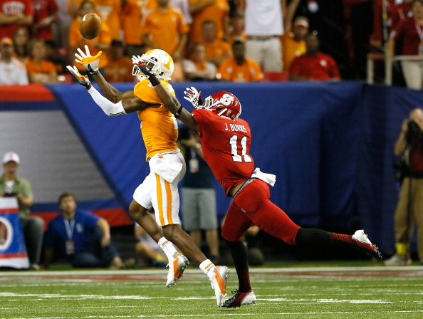 ATLANTA, GA - AUGUST 31:  Juston Burris #11 of the North Carolina State Wolfpack breaks up a pass intended for Justin Hunter #11 of the Tennessee Volunteers at Georgia Dome on August 31, 2012 in Atlanta, Georgia.  (Photo by Kevin C. Cox/Getty Images)