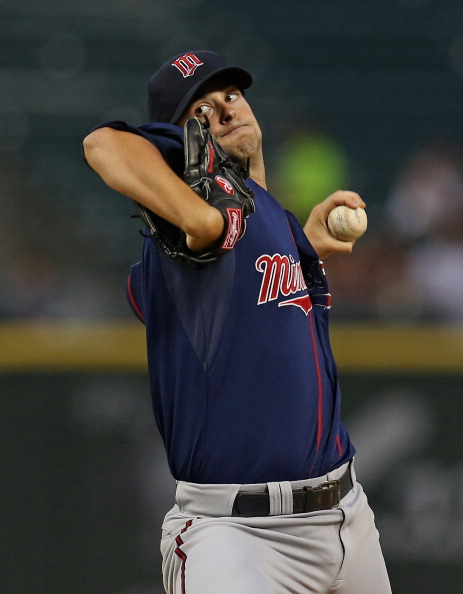 CHICAGO, IL - SEPTEMBER 04:  Starting pitcher Scott Diamond #58 of the Minnesota Twins delivers the ball against the Chicago White Sox at U.S. Cellular Field on September 4, 2012 in Chicago, Illinois.  (Photo by Jonathan Daniel/Getty Images)