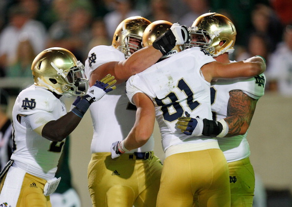 EAST LANSING, MI - SEPTEMBER 15:  John Goodman #81 of the Notre Dame Fighting Irish celebrates his first quarter touchdown with teammates while playing the Michigan State Spartans at Spartan Stadium Stadium on September 15, 2012 in East Lansing, Michigan. (Photo by Gregory Shamus/Getty Images)
