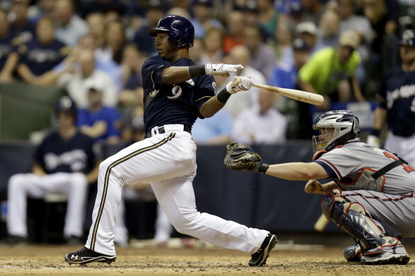 MILWAUKEE, WI - SEPTEMBER 11: Jean Segura #9 of the Milwaukee Brewers reached on fielder's as Aramis Ramirez crosses home plate against the Atlanta Braves during the bottom of the 7th inning at Miller Park on September 11, 2012 in Milwaukee, Wisconsin. (Photo by Mike McGinnis/Getty Images)