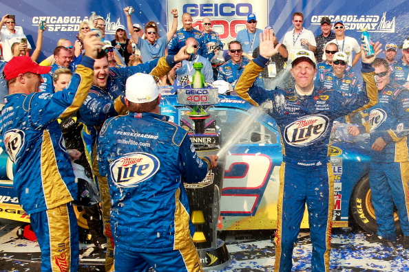 JOLIET, IL - SEPTEMBER 16:  Brad Keselowski, driver of the #2 Miller Lite Dodge, celebrates with his crew in Victory Lane after winning the NASCAR Sprint Cup Series GEICO 400 at Chicagoland Speedway on September 16, 2012 in Joliet, Illinois.  (Photo by Geoff Burke/Getty Images for NASCAR)