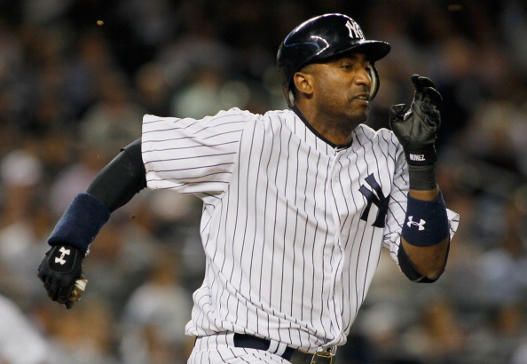 NEW YORK, NY - APRIL 17: Eduardo Nunez #26 of the New York Yankees runs out an RBI single in the third inning against the Minnesota Twins at Yankee Stadium on April 17, 2012 in the Bronx borough of New York City.  (Photo by Mike Stobe/Getty Images)