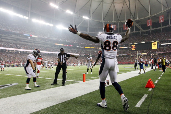 ATLANTA, GA - SEPTEMBER 17:  Wide receiver Demaryius Thomas #88 of the Denver Broncos celebrates after scoring a touchdown in the second quarter against the Atlanta Falcons during a game at the Georgia Dome on September 17, 2012 in Atlanta, Georgia.  (Photo by Kevin C. Cox/Getty Images)