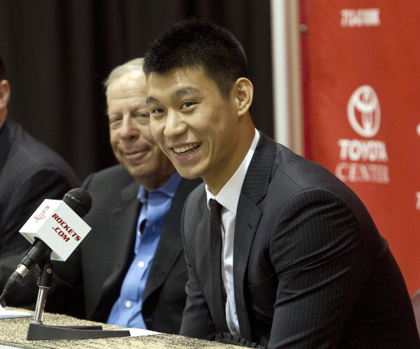 HOUSTON, TX - JULY 19: Jeremy Lin of the Houston Rockets speaks to the media as he is introduced during a press conference at Toyota Center on July 19, 2012 in Houston, Texas. Lin has signed a three year $25 million dollar contract with the Houston Rockets.  (Photo by Bob Levey/Getty Images)